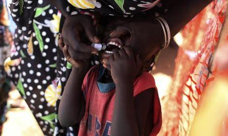 A displaced South Sudanese child receives an oral cholera vaccine in a camp for internally displaced people in the United Nations Mission in South Sudan (UNMISS) compound in Tomping, Juba February 28, 2014.  REUTERS/Andreea Campeanu