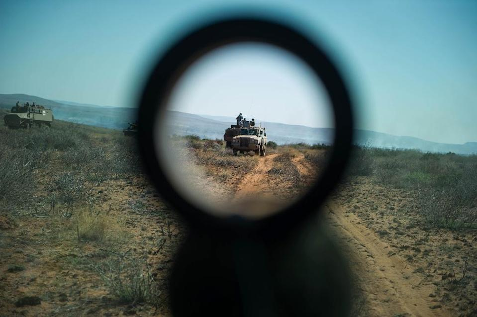 Seen through a sight, soldiers from different African countries take part in AMANI AFRICA II, the first military exercise of the African Union's African Standby Force, in Lohatla, South Africa, on October 28, 2015 (AFP Photo/Mujahid Safodien)