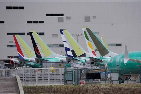 The tails of Boeing 737 MAX aircraft are seen at a Boeing production facility in Renton, Washington, U.S., March 11, 2019. REUTERS/David Ryder