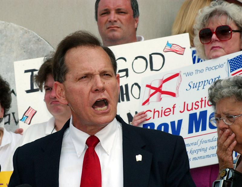 Then-Alabama chief justice Roy Moore speaks outside the state judicial building in Montgomery on Aug. 25, 2003. (Reuters Photographer / Reuters)