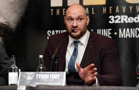 Boxing - Frank Warren and Tyson Fury Press Conference - Four Seasons Hotel, London, Britain - April 12, 2018 Tyson Fury during the press conference Action Images via Reuters/Tony O'Brien