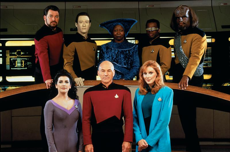Promotional portrait of the cast of 'Star Trek: The Next Generation,' California, 1987. Pictured are from left, front row, British-American actress Marina Sirtis (as Counselor Deanna Troi), British actor Patrick Stewart (as Captain Jean-Luc Picard), and American actress Gates McFadden (as Doctor Beverly Crusher); from left, back row, American actors Jonathan Frakes (as Commander William T. Riker), Brent Spiner (as Lieutenant Commander Data), Whoopi Goldberg (as Guinan), LeVar Burton (as Lieutenant Commander Geordi La Forge), and Michael Dorn (as Lieutenant Worf). (Photo by CBS Photo Archive/Getty Images)