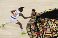 Atlanta Hawks' Trae Young, right, dribbles against New York Knicks' Reggie Bullock (25) during the first half in Game 4 of an NBA basketball first-round playoff series Sunday, May 30, 2021, in Atlanta. (AP Photo/Brynn Anderson)