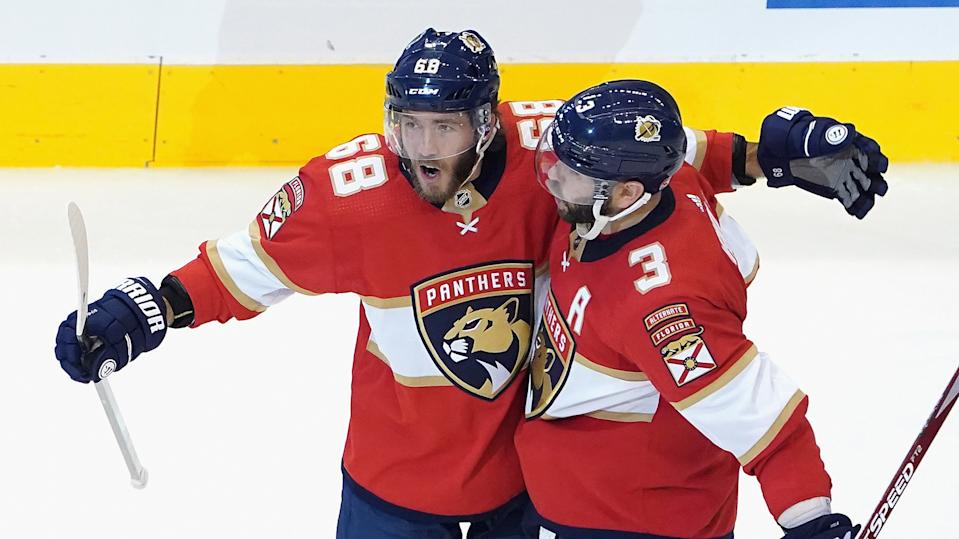 TORONTO, ONTARIO - AUGUST 05: Mike Hoffman #68 of the Florida Panthers (L) celebrates his power-play goal at 41 seconds of the third period against the New York Islanders and is joined by Keith Yandle #3 (R) in Game Three of the Eastern Conference Qualification Round prior to the 2020 NHL Stanley Cup Playoffs at Scotiabank Arena on August 5, 2020 in Toronto, Ontario, Canada. (Photo by Andre Ringuette/Freestyle Photo/Getty Images)