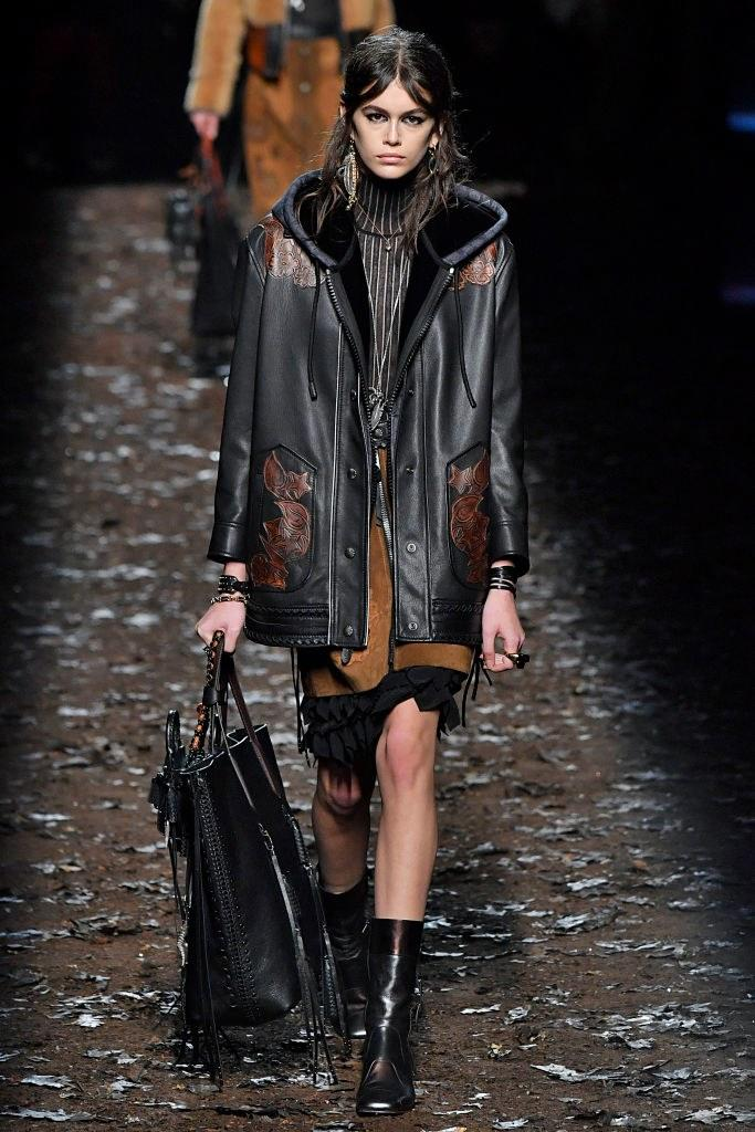 Kaia Gerber walks the runway at the Coach 1941 Ready to Wear Fall/Winter 2018-2019 Fashion show during New York Fashion Week on February 13, 2018 in New York City. Photo courtesy of Getty Images.