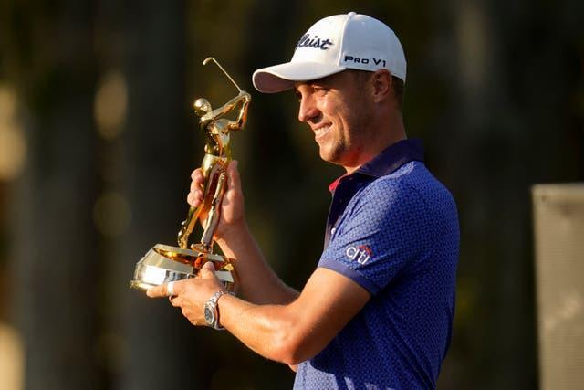 Justin Thomas holds the trophy after winning The Players Championship at TPC Sawgrass (Gerald Herbert/AP).