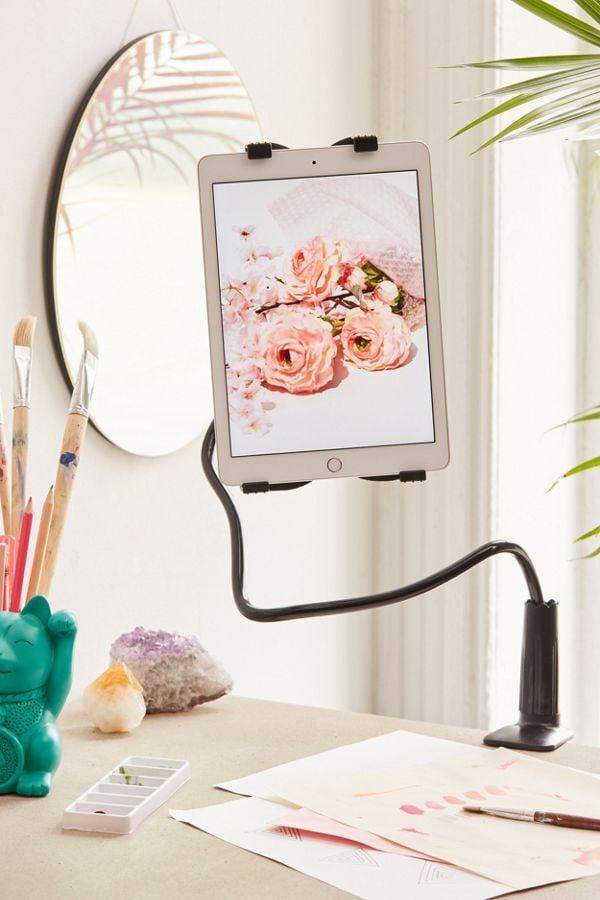 """<p>Put your tablet right where you need it with the help of this <a href=""""https://www.popsugar.com/buy/Universal-Tablet-Mount-395454?p_name=Universal%20Tablet%20Mount&retailer=urbanoutfitters.com&pid=395454&price=28&evar1=news%3Aus&evar9=36026397&evar98=https%3A%2F%2Fwww.popsugar.com%2Fnews%2Fphoto-gallery%2F36026397%2Fimage%2F45606027%2FUniversal-Tablet-Mount&list1=gifts%2Cgadgets%2Choliday%2Cgift%20guide%2Cdigital%20life%2Ctech%20gifts%2Cgifts%20for%20men&prop13=api&pdata=1"""" class=""""link rapid-noclick-resp"""" rel=""""nofollow noopener"""" target=""""_blank"""" data-ylk=""""slk:Universal Tablet Mount"""">Universal Tablet Mount</a> ($28).</p>"""