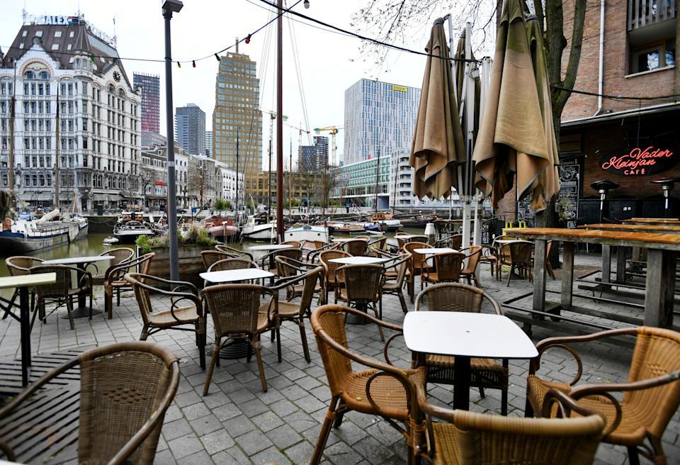 Empty terraces are seen in Rotterdam, where restaurants and bars have closed their doors in response to a rapidly expanding of the coronavirus disease (COVID-19), in Rotterdam, Netherlands March 16, 2020. REUTERS/Piroschka van de Wouw