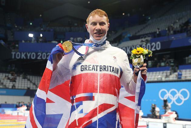 Tom Dean of Great Britain poses with his medal after winning the Men's 200m Freestyle final on day four of the Tokyo 2020 Olympic Games (Photo: Ian MacNicol via Getty Images)