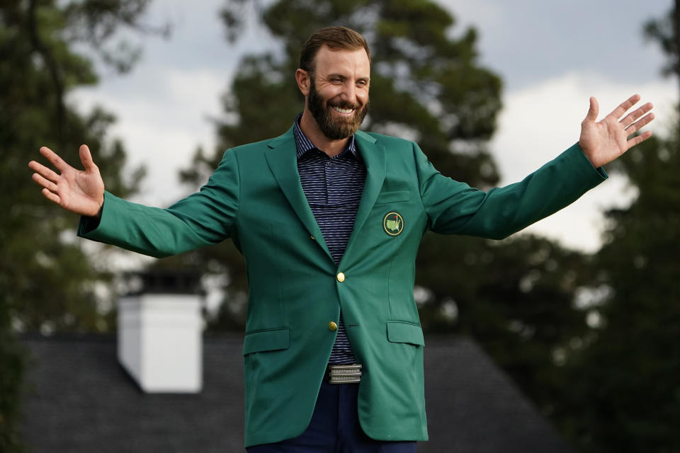 Masters golf champion Dustin Johnson shows off his green jacket after his victory Sunday, Nov. 15, 2020, in Augusta, Ga. (AP Photo/Matt Slocum)