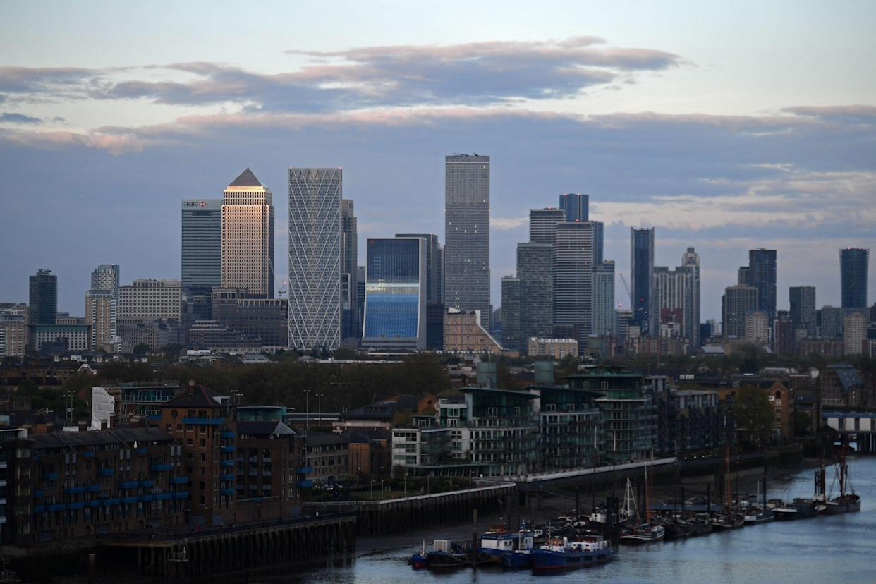 The secondary central business district of Canary Wharf is pictured as the sun sets in London
