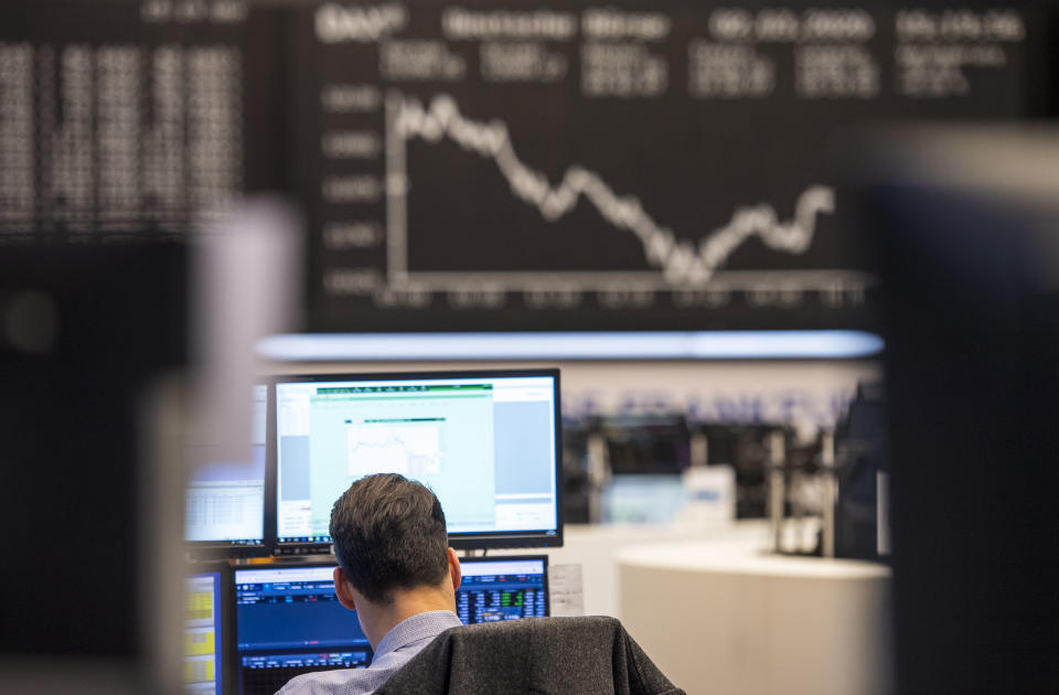 FRANKFURT AM MAIN, GERMANY - MARCH 02: A trader sits in desk pods on the trading floor of the Frankfurt Stock Exchange of the Deutsche Boerse AG on March 2, 2020 in Frankfurt, Germany. Europe is braced for more fallout from the coronavirus as confirmed cases of Covid-19, the disease caused by the coronavirus, have reached at least 117 in Germany and are expected to continue rising.  (Photo by Thomas Lohnes/Getty Images)
