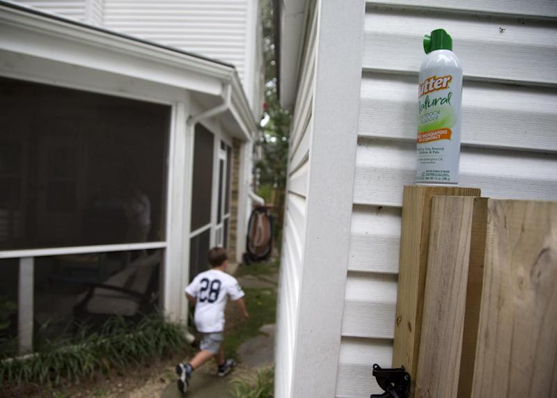 Ryan Miller's son Seaton Miller, 4, runs between homes in Arlington, Va., Monday, Aug. 19, 2013, past a can of bug spray. Miller has been lobbying his local government to break out the pesticides this year to fight mosquitos. Despite our size and technological advantages, we still can't seem to win our ancient blood battle with the pesky and lethal mosquito. In much of the nation this summer you can tell just by looking at the itchy bumps on our arms. A large section of the United States seems like it is getting eaten alive worse than usual this summer because of quirks in recent weather. It may be the worst in the Southeast, where after two years of drought when mosquito eggs laid dormant, there have been incredibly heavy rains much of the spring and summer. Rainfall in parts of North Carolina is more than two feet above normal this year. The rains have revived the dormant eggs, so the region is essentially getting three years' worth of mosquitoes in one summer. (AP Photo/Carolyn Kaster)