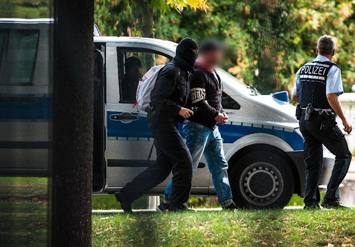 Police escort a suspected right-wing terrorist after arriving at court in Karlsruhe, southwestern Germany (AFP Photo/Christoph Schmidt)