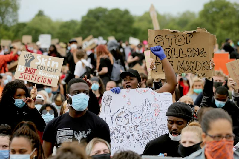 Participants hold placards in a Black Lives Matter protest rally in Hyde Park, London, in memory of George Floyd who was killed on May 25 while in police custody in the US city of Minneapolis. Picture date: Wednesday June 3, 2020.