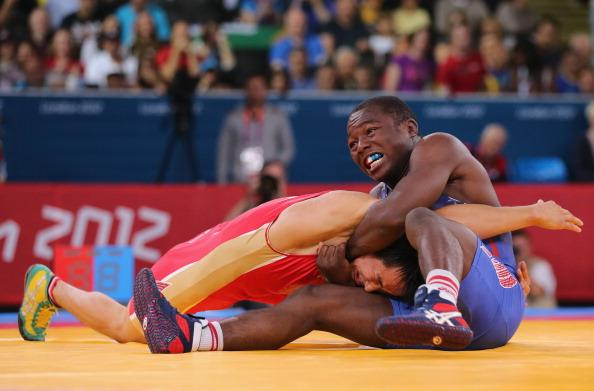 LONDON, ENGLAND - AUGUST 05:  Mingiyan Semenov of Russia competes with Spenser Thomas Mango of the United States during the Men's Greco-Roman 55 kg Wrestling Repechage on Day 9 of the London 2012 Olympic Games at ExCeL on August 5, 2012 in London, England.  (Photo by Scott Heavey/Getty Images)