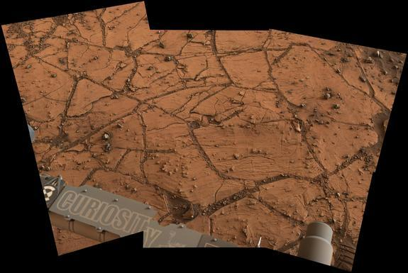 A patch of Martian bedrock, about 2 feet (70 centimeters) across appears to consist of finely layered rock with some pea-size inclusions. NASA's Curiosity Mars rover acquired this view on Nov. 9, 2014.