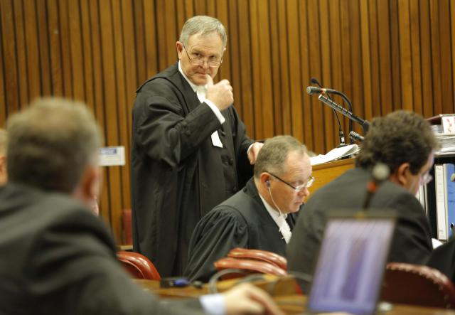 Defense attorney for Oscar Pistorius, Barry Roux, makes a point in court in Pretoria, South Africa, Friday, March 14, 2014 on the tenth day of proceedings. Pistorius is charged with the shooting death of his girlfriend Reeva Steenkamp, on Valentines Day in 2013. (AP Photo/Kim Ludbrook, Pool)