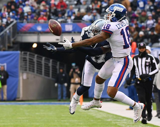 <p>Dallas Cowboys cornerback Jourdan Lewis (27) breaks up a pass intended for New York Giants wide receiver Roger Lewis (18) during a NFL football game at MetLife Stadium. Mandatory Credit: Robert Deutsch-USA TODAY Sports </p>