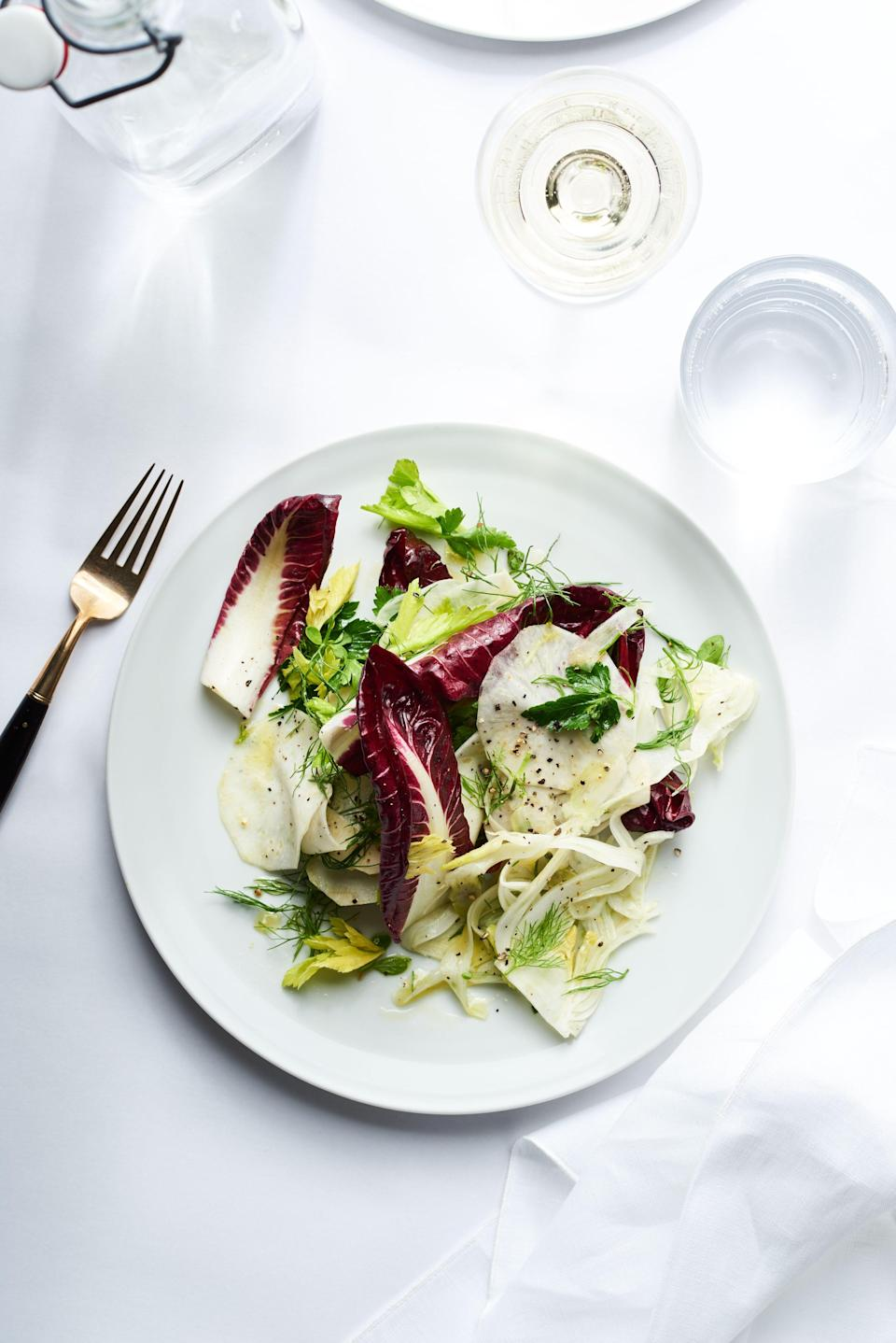 """Simplicity relies on quality. Be choosy when picking your produce, and look for a new-harvest olive oil for this, which will lend a bright, robust flavor. <a href=""""https://www.bonappetit.com/recipe/fennel-and-celery-root-salad?mbid=synd_yahoo_rss"""" rel=""""nofollow noopener"""" target=""""_blank"""" data-ylk=""""slk:See recipe."""" class=""""link rapid-noclick-resp"""">See recipe.</a>"""