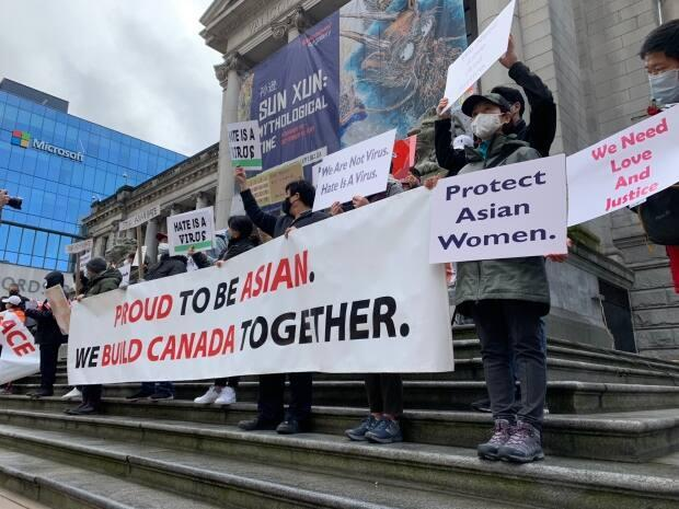 About 500 people were at the Vancouver Art Gallery on March 28 to protest against anti-Asian hate. The sharp rise in anti-Asian hate crimes since the pandemic has many Asian Canadians seeking mental health support, says a racial trauma therapist. (Jon Hernandez/CBC - image credit)