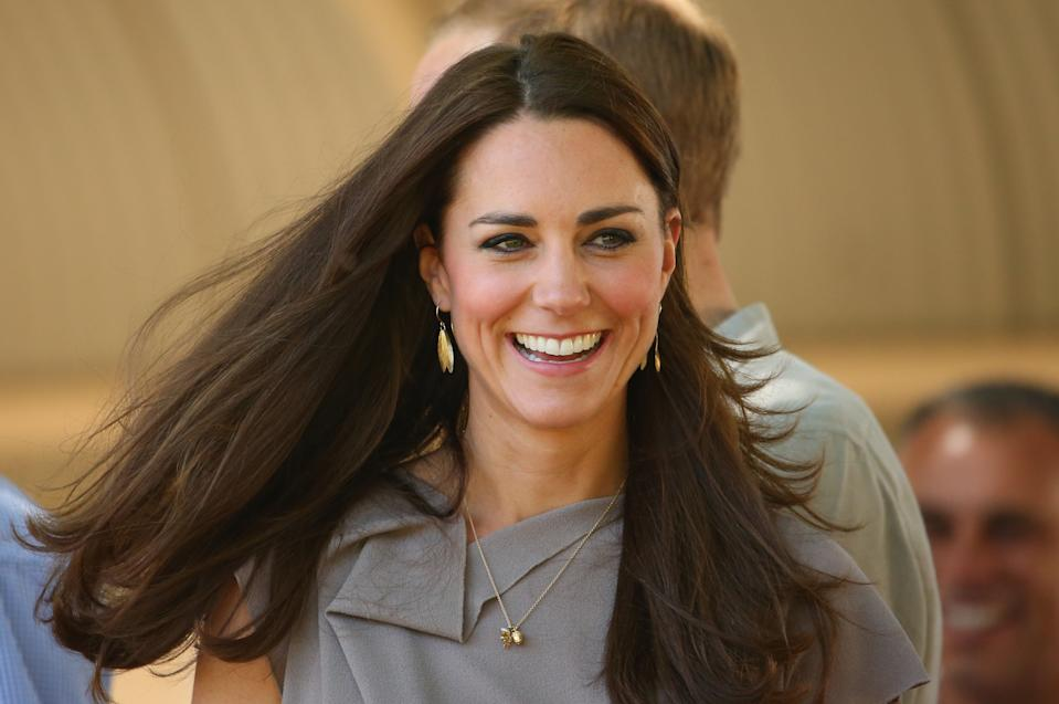 AYERS ROCK, AUSTRALIA - APRIL 22:  Catherine, Duchess of Cambridge smiles as she arives at the National Indigenous Training Academy on April 22, 2014 in Ayers Rock, Australia. The Duke and Duchess of Cambridge are on a three-week tour of Australia and New Zealand, the first official trip overseas with their son, Prince George of Cambridge.  (Photo by Scott Barbour/Getty Images)