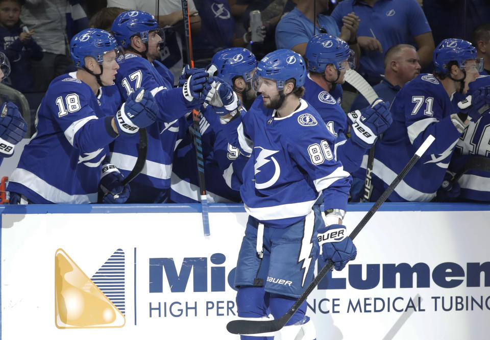 Tampa Bay Lightning right wing Nikita Kucherov (86) celebrates with the bench after scoring against the Florida Panthers during the first period of an NHL hockey game Thursday, Oct. 3, 2019, in Tampa, Fla. (AP Photo/Chris O'Meara)