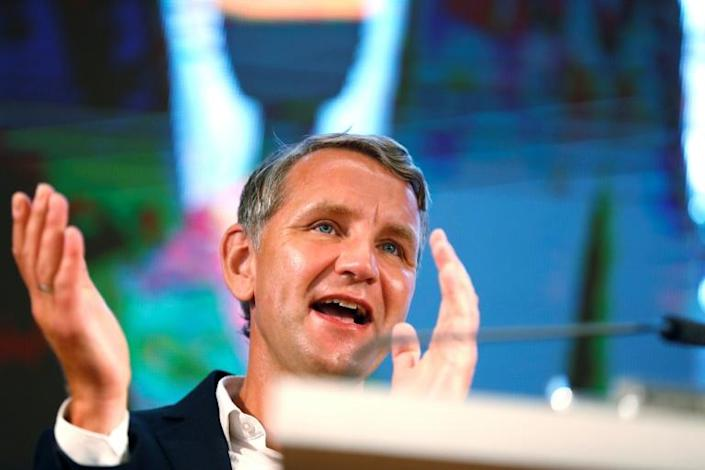 Bjoern Hoecke reacts on stage after evidence emerges of the AfD's surge (AFP Photo/Odd ANDERSEN)