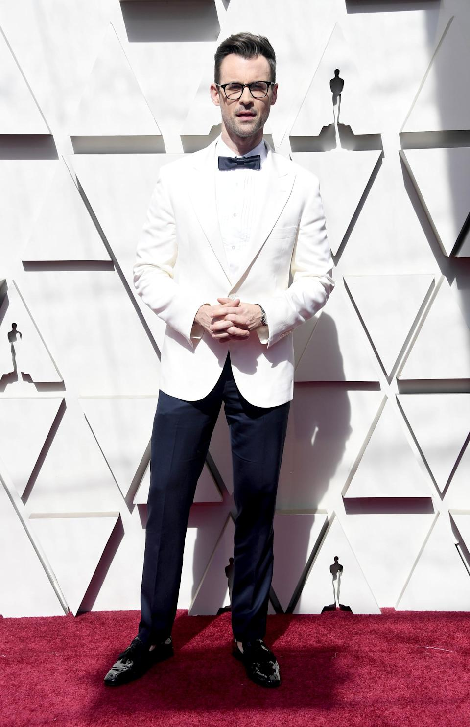 <p>Wearing a Brunello Cucinelli suit with Garrett Leight glasses, Cartier jewels, and Christian Louboutin shoes.</p>