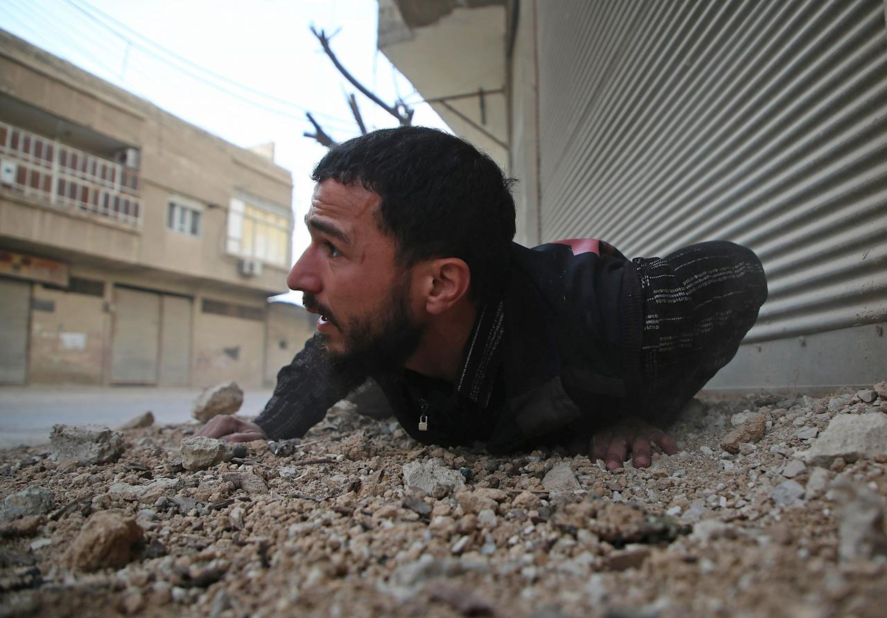 <p>A Syrian man reacts following an air strike in the rebel-held enclave of Arbin in the Eastern Ghouta near Damascus on Feb. 8, 2018. (Photo: Amer Almohibany/AFP/Getty Images) </p>
