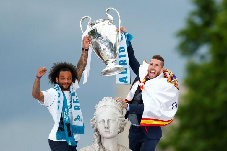 Ramos and Marcelo celebrate after an unprecedented third consecutive Champions League success in 2018, parading the trophy in Madrid's Cibeles square