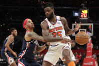Washington Wizards' Shabazz Napier, front left, knocks the ball away from New York Knicks' Reggie Bullock (25) during the first half of an NBA basketball game Tuesday, March 10, 2020, in Washington. (AP Photo/Luis M. Alvarez)