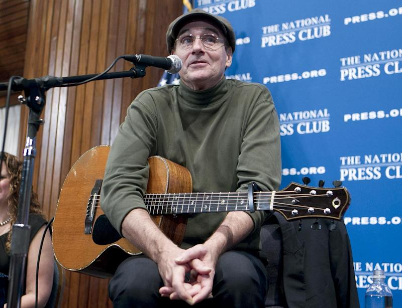FILE - In this Dec. 7, 2012 file photo, Grammy Award-winning singer-songwriter James Taylor speaks during a news conference at the National Press Club in Washington, where talked about politics and music and entertained the crowd, a day after performing at 90th annual National Christmas Tree Lighting in Washington. Kelly Clarkson and fun. are just two of the acts who will perform during the upcoming inaugural festivities, which also includes Beyonce, James Taylor, Stevie Wonder, Katy Perry and dozens of others. (AP Photo/Jose Luis Magana, File)