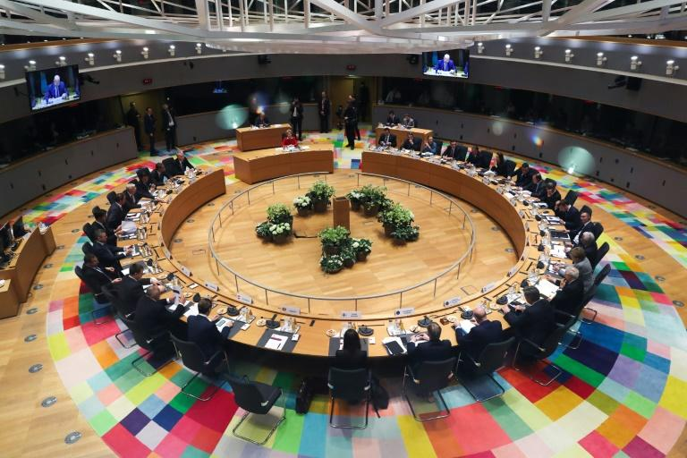European Union leaders gather around the table to try to bridge the divide over the next long-term EU budget. But they did not succeed. (AFP Photo/YVES HERMAN)