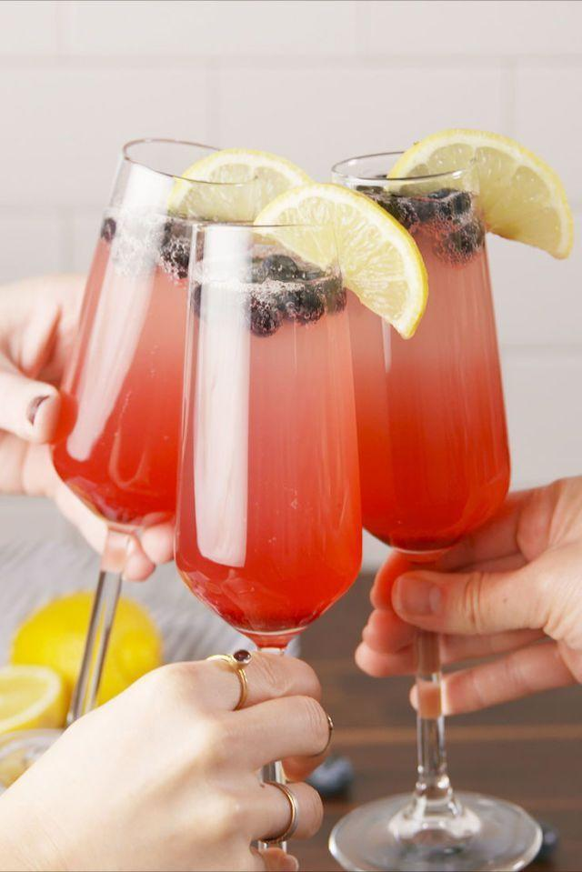 """<p>Give your classic mimosa a patriotic makeover by swapping orange juice for lemonade and adding in some blueberries.</p><p><em><strong>Get the recipe at <a href=""""https://www.delish.com/cooking/recipe-ideas/recipes/a58461/lemosas-recipe/"""" rel=""""nofollow noopener"""" target=""""_blank"""" data-ylk=""""slk:Delish"""" class=""""link rapid-noclick-resp"""">Delish</a>.</strong></em> </p>"""
