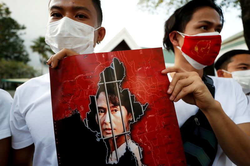 FILE PHOTO: Myanmar citizens hold up a picture of leader Aung San Suu Kyi after the military seized power in a coup in Myanmar, outside United Nations venue in Bangkok