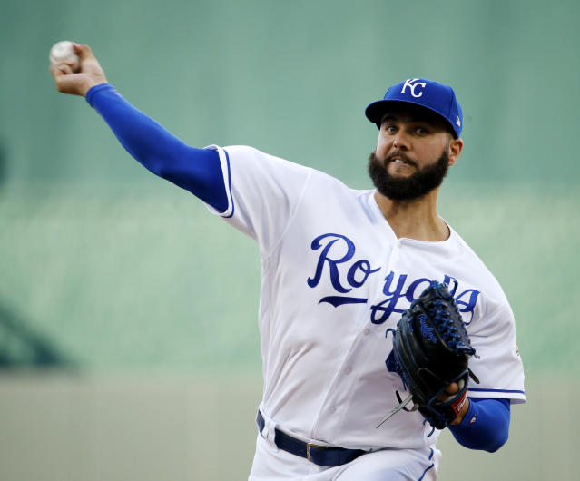 Kansas City Royals starting pitcher Jakob Junis throws during the first inning of the team's baseball game against the Texas Rangers on Wednesday, June 20, 2018, in Kansas City, Mo. (AP Photo/Charlie Riedel)