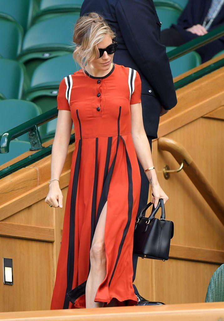 <p>Miller wore a red, black, and white dress for Wimbledon. </p>
