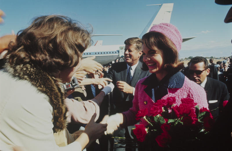 President John F. Kennedy and his wife, Jacqueline Kennedy, are seen after arriving in Dallas, Texas, on Nov. 22, 1963. He was fatally shot that same day. (Art Rickerby via Getty Images)