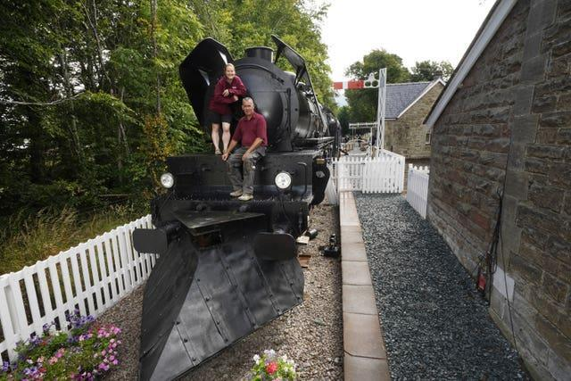 Simon and Diana Parums with their full-size steam train with carriages, tracks and platform as they converted and restored Bassenthwaite Lake station in Keswick