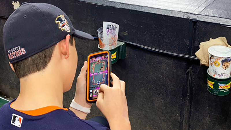 The kid, pictured here playing on his phone instead of watching the World Series.