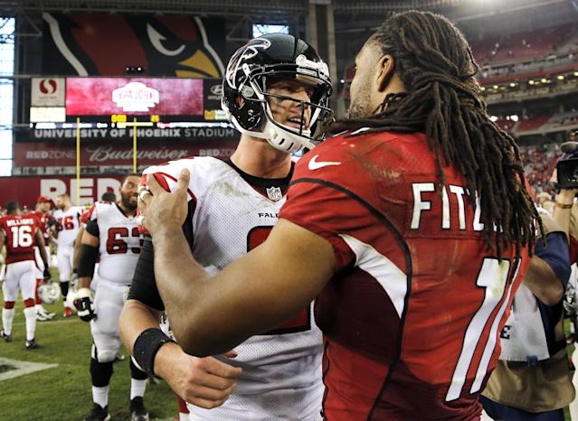 Arizona Cardinals wide receiver Larry Fitzgerald, right, greets Atlanta Falcons quarterback Matt Ryan after an NFL football game Sunday, Oct. 27, 2013, in Glendale, Ariz. The Cardinals won 27-13. (AP Photo/Rick Scuteri)