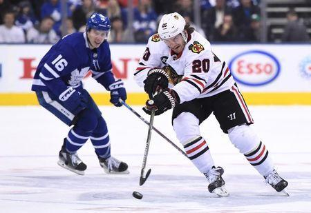 Mar 13, 2019; Toronto, Ontario, CAN; Chicago Black Hawks forward Brandon Saad (20) shoots the puck away from Toronto Maple Leafs forward Mitchell Marner (16) in the first period at Scotiabank Arena. Mandatory Credit: Dan Hamilton-USA TODAY Sports