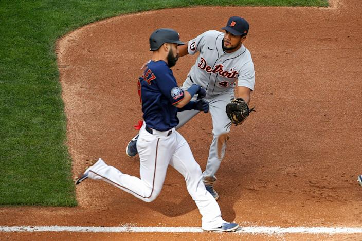 Detroit Tigers first baseman Jeimer Candelario, right, tags out Minnesota Twins' Marwin Gonzalez on a ground ball in the fourth inning Friday, Sept. 4, 2020, in Minneapolis.