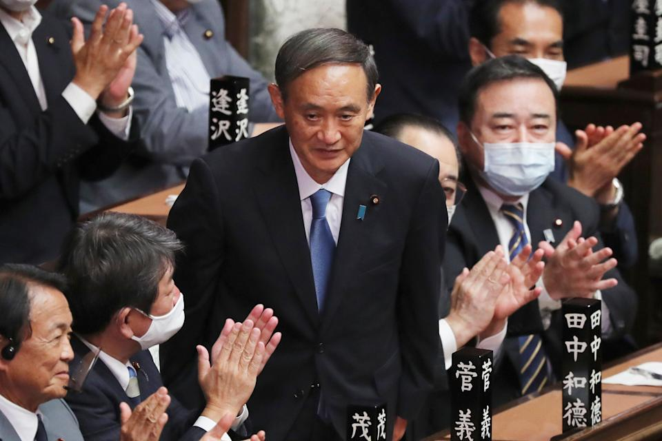 Yoshihide Suga is applauded after being elected as Japan's new prime minister at parliament's lower house in Tokyo, Wednesday, Sept. 16, 2020. Suga was formally elected Wednesday as Japan's new prime minister in a parliamentary vote, replacing Shinzo Abe. (AP Photo/Koji Sasahara) (Photo: ASSOCIATED PRESS)