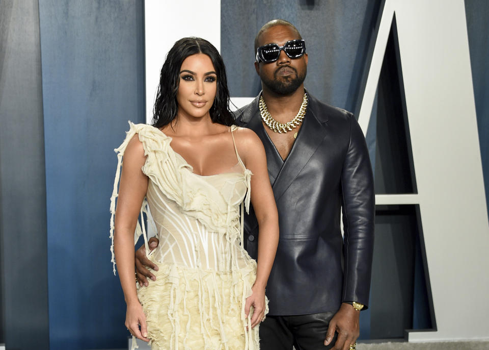 Kim Kardashian West, left, and Kanye West arrive at the Vanity Fair Oscar Party on Sunday, Feb. 9, 2020, in Beverly Hills, Calif. (Photo by Evan Agostini/Invision/AP)