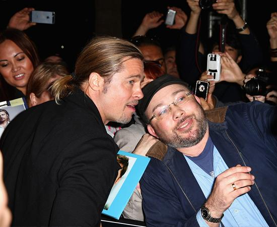 Brad Pitt took the time to sign autographs and take photos with the enthusiastic fans at the Sydney premiere of his latest film.