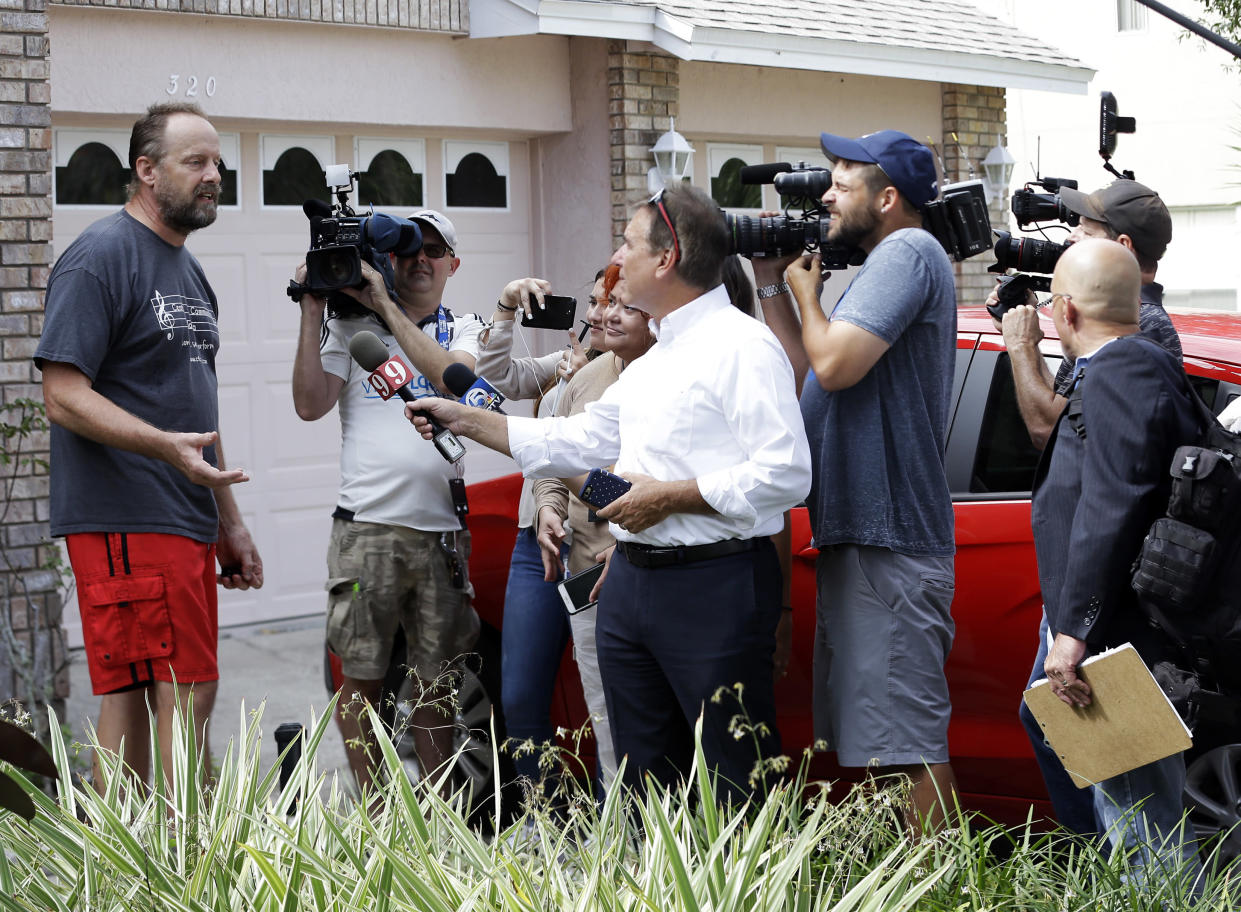 "Eric Paddock, left, brother of Las Vegas gunman Stephen Paddock, speaks to members of the media outside his home in Orlando, Fla. Paddock told the Orlando Sentinel: ""We are completely dumbfounded. We can't understand what happened."" (Photo: John Raoux/AP)"