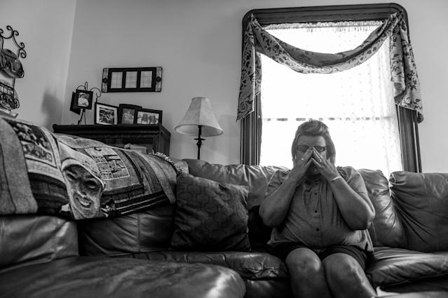 <p>Beth Genslinger mourns the death of her son Andy, who died from a heroin overdose in his bedroom in Germantown, Ohio. He is pictured on a blanket next to her.<br> (Photograph by Mary F. Calvert for Yahoo News) </p>