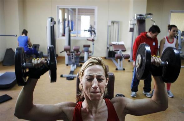 Spanish boxer Jennifer Miranda lifts weights during a training session at a high-performance sports centre in Los Alcazares, southeastern Spain, April 3, 2012.